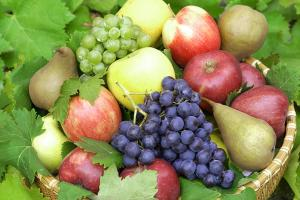 Fruit basket with grapes, pears and apples